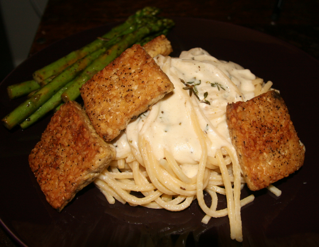Pan Seared Tempeh with basil cream linguine